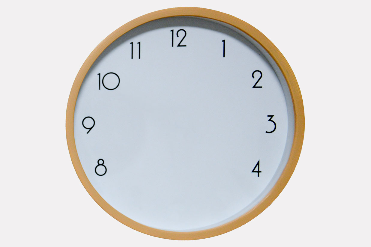 wall clock with no hands and missing the numbers 5, 6, and 7